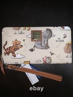 NWT Disney Dooney & Bourke Winnie The Pooh Wallet In Hand. Ships Today. Disney